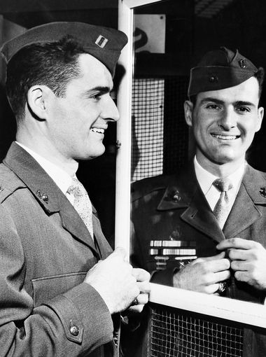 New York Yankee infielder Jerry Coleman tries on a uniform in San Francisco Jan. 10, 1952, after being recalled for active duty with the U.S. Marine Corps. Coleman, a Marine fighter pilot, flew 57 missions during World War II.  AP