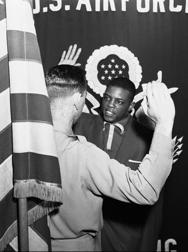 Willie Mays, center fielder for the New York Giants, is sworn in as a private at the U.S. Army induction center at 39 Whitehall St. in New York City on May 29, 1952.  Anthony Camerano, AP