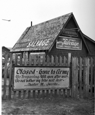 'Gone to Army' A sign on this Oklahoma City, Oklahoma, automobile salvage store proudly proclaims that the place is closed because the owner, one Chester M. Jacobs, has joined the Army for the duration of the war. November 1942.