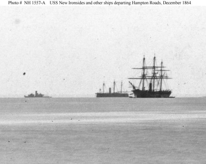 Ships of the North Atlantic Blockading Squadron departing Hampton Roads, Virginia, en route to attack Fort Fisher, North Carolina, in December 1864. The ships present are (from left to right): A twin-turret monitor, probably USS Monadnock; USS New Ironsides and a steam sloop of war. This image is cropped from Photo # NH 1557. U.S. Naval Historical Center Photograph.