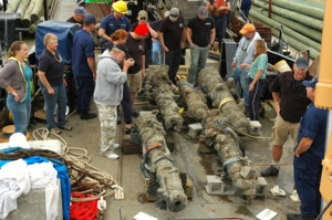 State underwater archaeologists and members of the U.S. Coast Guard cutter Smilax check out the five cannons they retrieved Monday from the Queen Anne's Revenge shipwreck. (Cheryl Burke photo) @cherylccn  Cheryl@thenewstimes.com