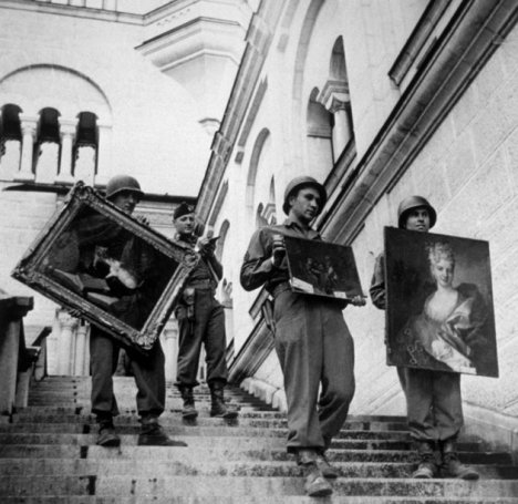 American soldiers carry rescued paintings in Bavaria, May 1945. (Keystone/Getty Images)