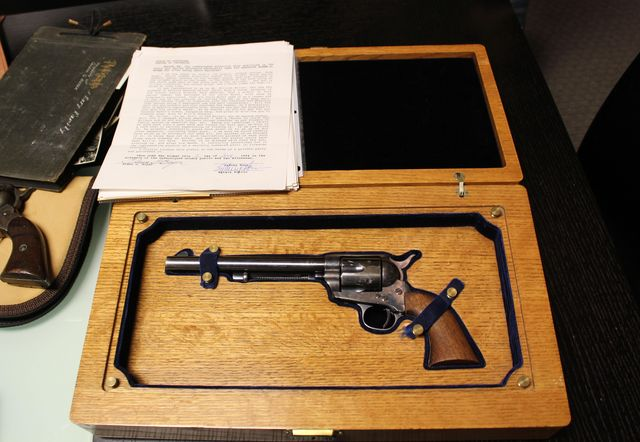 This undated photo provided by Olson Communications shows a Colt .45 revolver believed to have been carried by Wyatt Earp during the O.K. Corral shootout in Tombstone, Ariz. The gun sold at an auction of of numerous items related to Earp and his family Thursday, April 17, 2014 for $225,000 in Scotsdale, Az. (AP Photo/Courtesy of Olson Communications, Josh Skalniak).